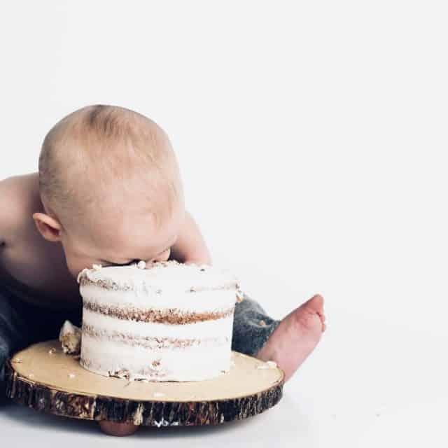Vegan baby eating cake