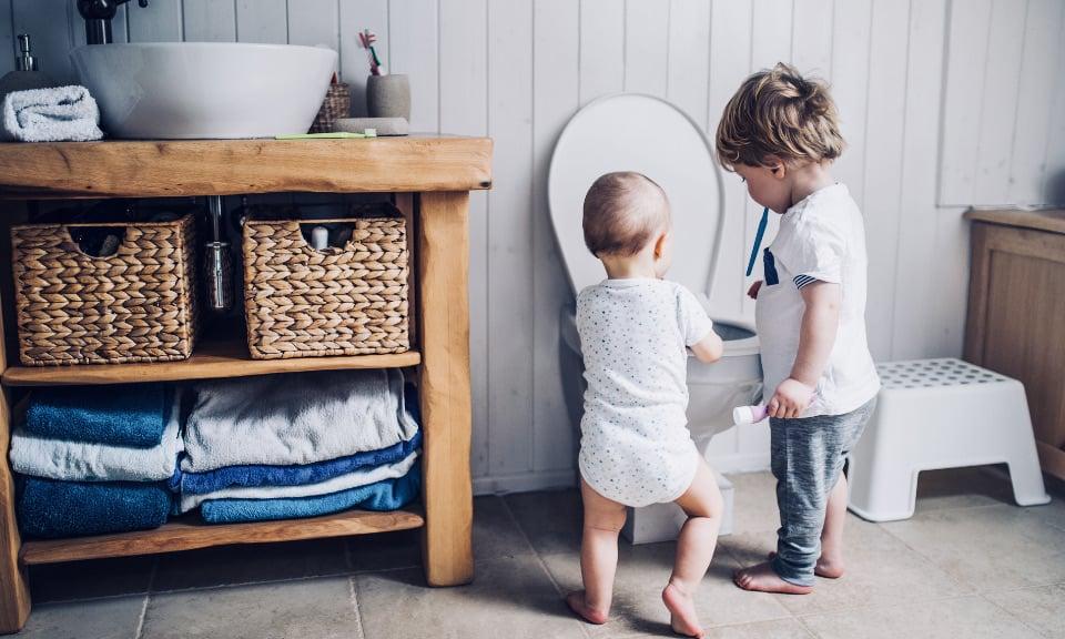 Children playing in toilet
